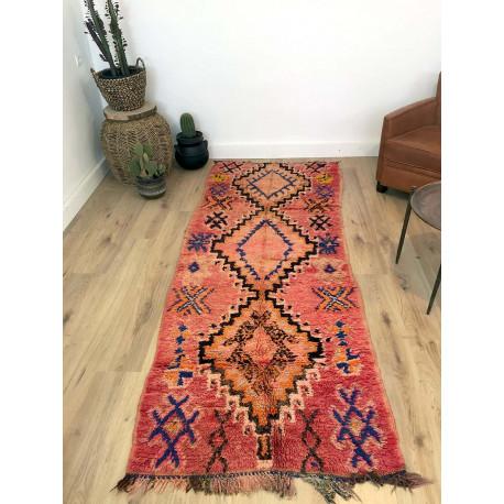 Tapis berbère fond orange rosé laine pure aux motifs ethniques